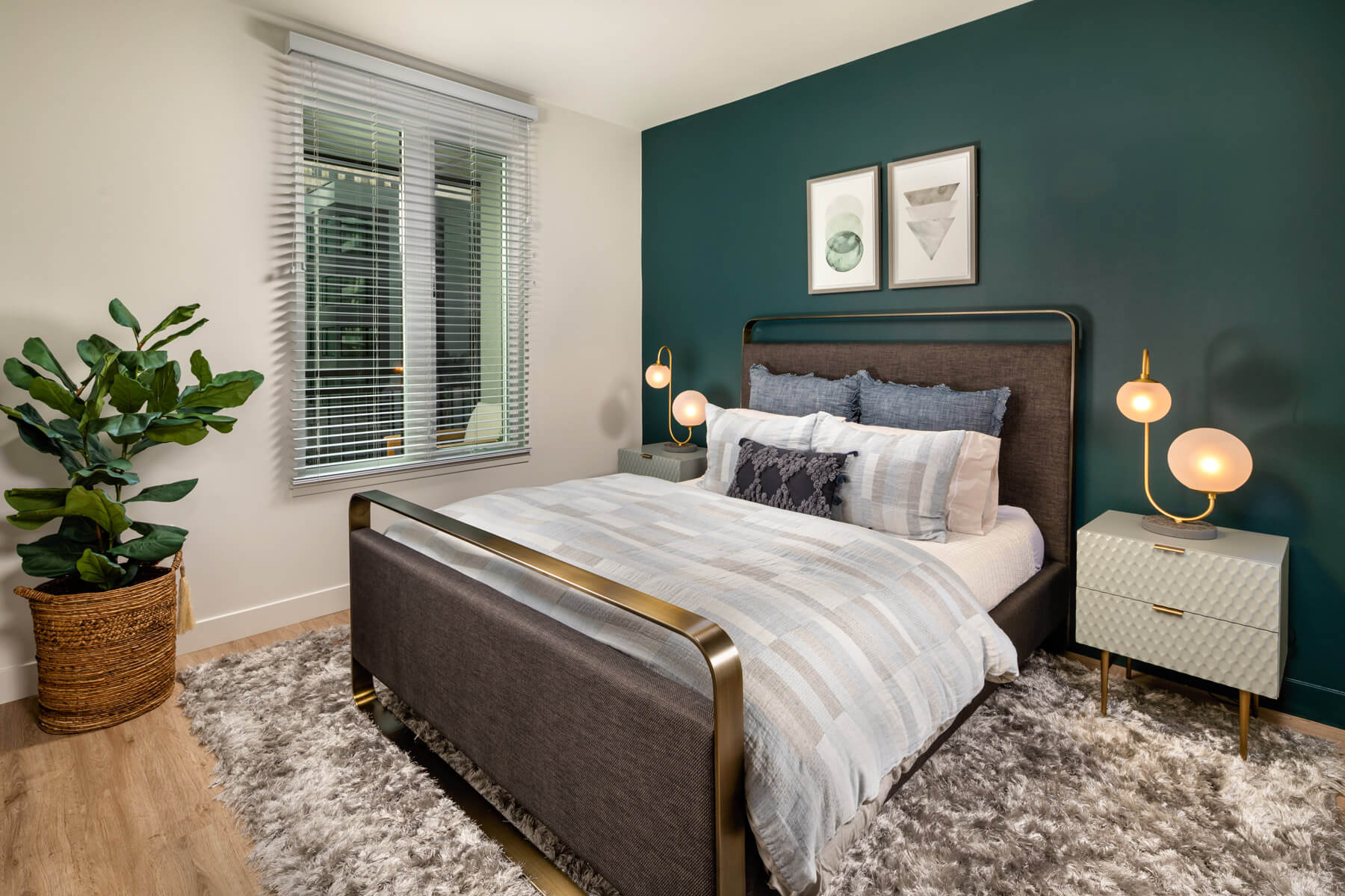 DTLA Apartments - Spacious Master Bedroom With Beautiful Hardwood Floors, Gorgeous Forrest Green Accent Wall, and Window With View