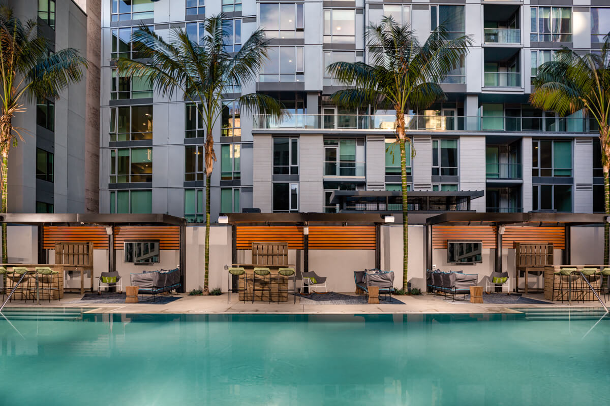 Downtown Los Angeles Apartments for Rent - Sparkling Third-Floor Swimming Pool Surrounded by LA Skyline, Private Cabanas, Umbrellas, and Comfortable Plush Lounge Chairs